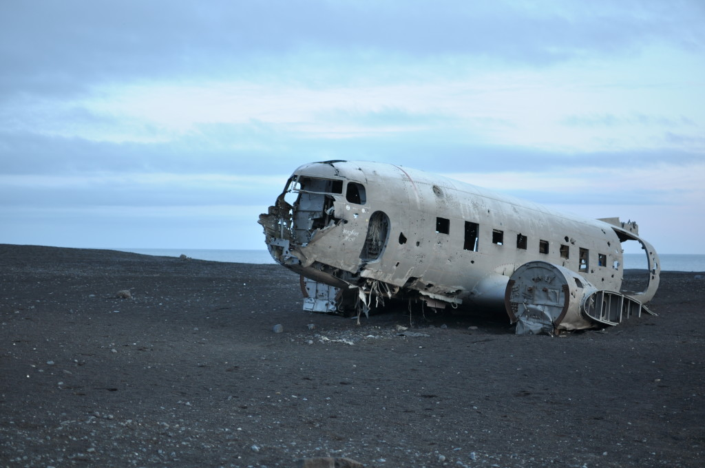 The plane wreck on the moon—er, rather, near Skógafoss, a destination for photographers.