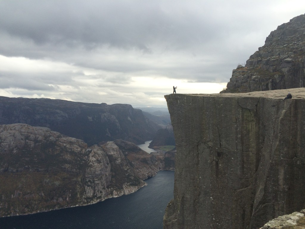 "My first sight of Prekestolen. Lysefjord below. Is that man taking a selfie or doing tai chi? (Notably, the Norweigans have developed the term ""fjellfie,"" or ""mountain selfie""; I admit I think it's cute.)"